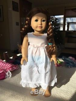 American Girl Saige Doll comes with four outfits including the original dress