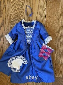 Retired American Girl/Pleasant Company Felicity withclothes, book, dining set
